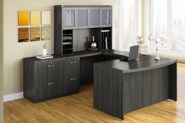 The look for less. Aberdeen® balances the look of wood with the performance and affordability of laminate. Textured glass and brushed nickel accents further enhance the upscale appeal, while technology-supportive features boost functionality. Elegant enough for the executive suite, flexible enough for team environments, Aberdeen® can furnish your entire office with ease.