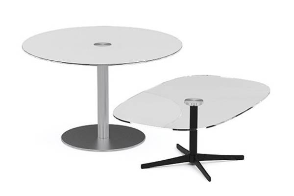 Axium tables come in a variety of materials, shapes, sizes and heights. Clear and white back painted security glass provide an affordable, attractive and durable surface for café and break areas. Wood tops feature an elegant expressed plywood knife edge to match our Cempa side chair oak and walnut finishes, while the simple white laminate tops pair well with the X and disc bases. Most tops are available in occasional, lounge, desk and bar heights and are offered with bright metal or black matte base finishes.